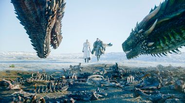 This image released by HBO shows  Emilia Clarke, left, and Kit Harington in a scene from