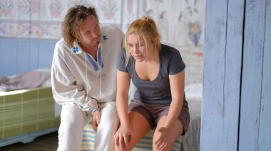 This image released by A24 shows Vilhelm Blomgren, left, and Florence Pugh in a scene from the horror film