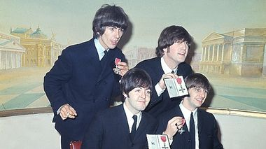 The Beatles show their MBE medals during a news conference in London, England, Oct. 26, 1965.  They were made members of the Order of the British Empire by the Queen of England at Buckingham Palace.  The quartet are, standing, George Harrison, left, John Lennon; seated, Paul McCartney, left, and Ringo Starr.  (AP Photo)