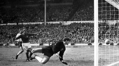 England's controversial third goal scored by Geoff Hurst, unseen, during the Football World Cup Final at Wembley Stadium, London, on July 30, 1966, as German goalkeeper Hans Tilkowski dives for the ball watched by England's Roger Hunt, with arms raised. After consulting with the linesman the referee decided the ball had crossed the line after the shot hit the crossbar and rebounded down. England defeated West Germany, after extra-time, 4-2. (AP Photo/Bippa)