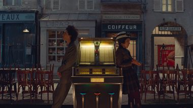Timothée Chalamet and Lyna Khoudri in the film THE FRENCH DISPATCH. Photo Courtesy of Searchlight Pictures. © 2021 20th Century Studios All Rights Reserved