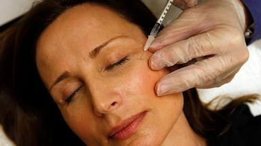 Colleen Delsack, 47, of Alexandria, Va., has Botox injected by Dr. Shannon Ginnan, at Reveal in Arlington, Va. on Friday, June 5, 2009. Reveal is offering free injections of the anti-wrinkle drug Botox to the first 50 people who stop by Friday clutching a resume. The event will feature recruiters offering tips, networking opportunities and on-site interviews. And, of course, there's also this pitch: confidence inspired by Botox could give job seekers an edge in the hiring process. (AP Photo/Jacquelyn Martin)